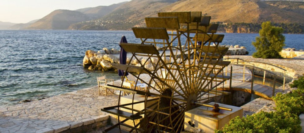 Romantic scenic coastal Fanari road in Lassi Kefalonia, Water Wheel.